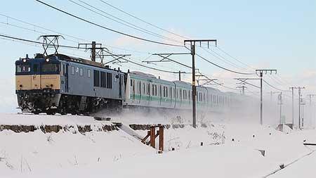 E233系7000番台ハエ121編成が配給輸送される
